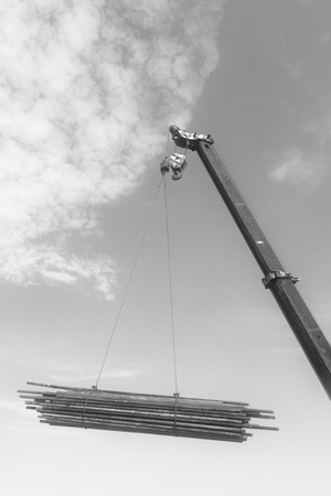 displacement: Crane sling under the blue sky and white clouds, at a construction site, china