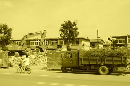 Luannan County, July 30: House demolition site, transportation of waste steel three yard car on July 30, 2012, Luannan, Hebei, China.