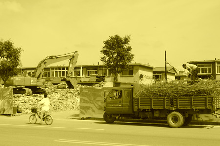 house demolition: Luannan County, July 30: House demolition site, transportation of waste steel three yard car on July 30, 2012, Luannan, Hebei, China.