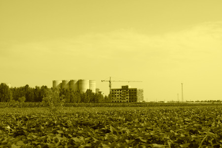 agricultural engineering: Farmland and unfinished building in the blue sky, China Editorial