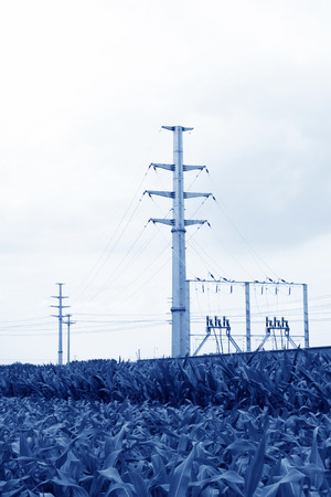 transmission line: High voltage power transmission lines in the green farmland, in MaCheng iron mine on July 12, 2012, Luannan County, Hebei Province, China Stock Photo