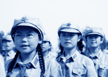 swear: LUANNAN COUNTY - JULY 16: The Elementary student dressed in blue military uniform, solemnly swear, on July 16, 2012, luannan county, Hebei province, China Editorial