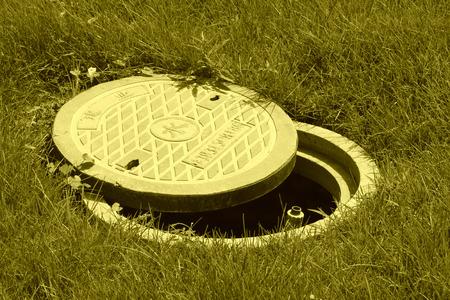 municipal utilities: Municipal sewage manhole cover in a park north china