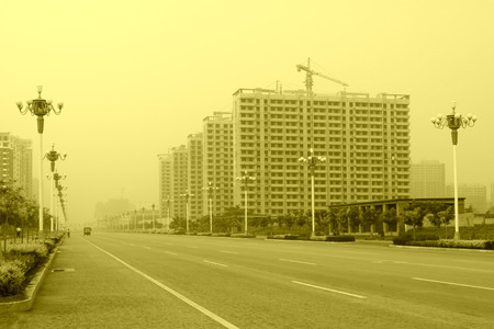 city road: City road landscape in the mist, northern china