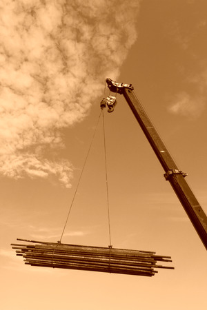 Crane sling under the blue sky and white clouds, at a construction site, china photo