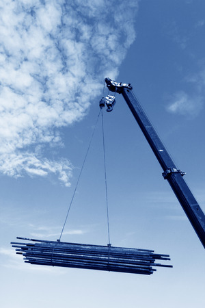 sling: Crane sling under the blue sky and white clouds, at a construction site, china