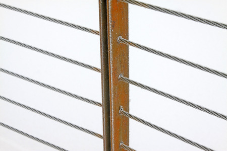 toughness: Wire rope and metal pillar in the frost and snow