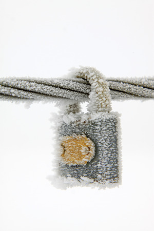 wire rope: Wire rope and locks in the frost and snow, closeup of photo