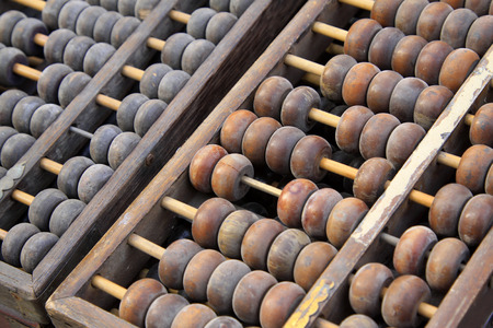 calculator chinese: Chinese traditional calculator - abacus, closeup of photo
