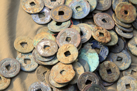 seized: Chinese ancient metal currency, closeup of photo