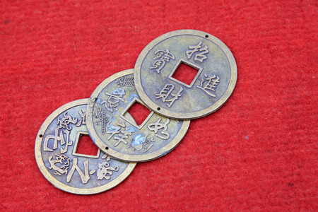 breakage: Chinese ancient metal currency, closeup of photo
