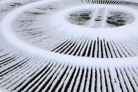 metal shield: Fountain metal shield in the snow, closeup of photo
