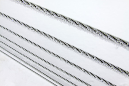 wire rope: Wire rope in the frost and snow, closeup of photo