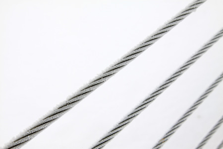 toughness: Wire rope in the frost and snow Stock Photo