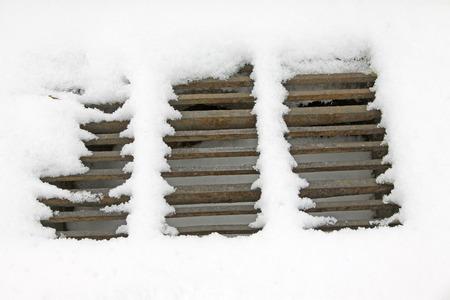crossings: water crossings metal cover in the snow, closeup of photo