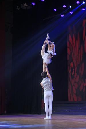 acrobatics: LUANNAN COUNTY - DECEMBER 28: Chinese Traditional acrobatics performance - shoulder ballet on December 28, 2014, Luannan County, Hebei Province, China