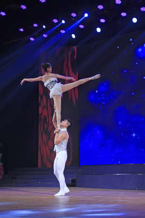 the acrobatics: LUANNAN COUNTY - DECEMBER 28: Chinese Traditional acrobatics performance - shoulder ballet on December 28, 2014, Luannan County, Hebei Province, China