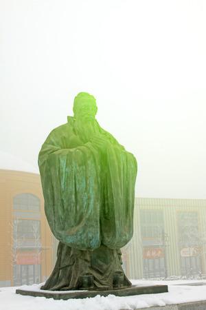 scholars: ancient China Confucian scholars sculpture, closeup of photo