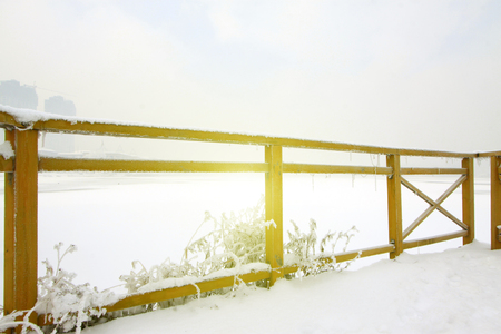 dazzle: Wooden baluster in the snow, closeup of photo