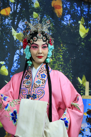 role models: LUANNAN  COUNTY - DECEMBER 13: Chinese traditional PingJu woman classical costumes, on december 13, 2014, Luannan County, Hebei Province, China