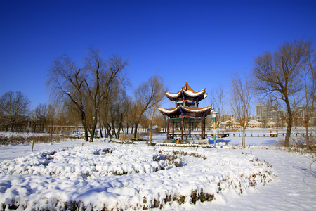 city park pavilion: traditional Chinese architectural style pavilion in a park Editorial
