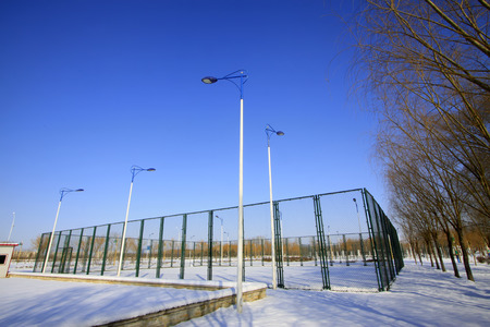 tennis courts:  tennis courts in the snow, closeup of photo
