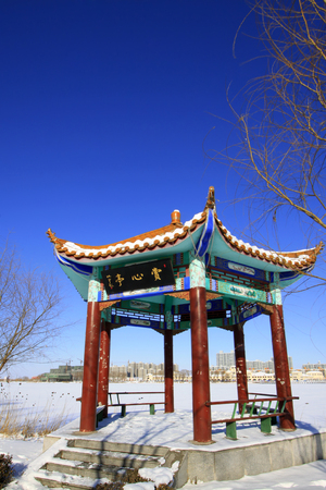 wider: LUANNAN COUNTY - DECEMBER 31: traditional Chinese architectural style pavilion in a park, on december 31, 2015, Luannan County, Hebei Province, China Editorial