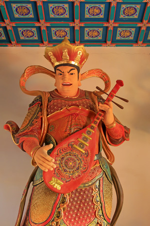 pipa:  Heavenly Kings holding Pipa statue in Dajue Temple