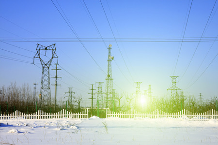 Electric power tower in the snow, closeup of photo