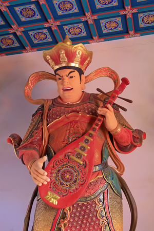pipa: LUAN COUNTY - January 10, Heavenly Kings holding Pipa statue in Dajue Temple, January 10, 2015, Luan County, Hebei Province, China