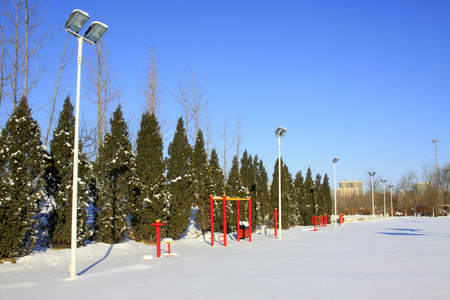 outdoor exercise: Fitness equipment in the snow, closeup of photo