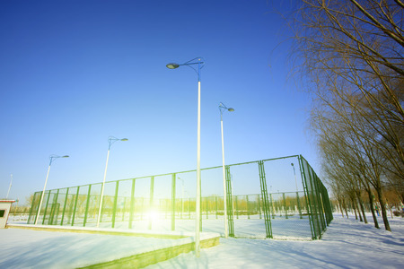 tennis courts: Park tennis courts in the snow, closeup of photo