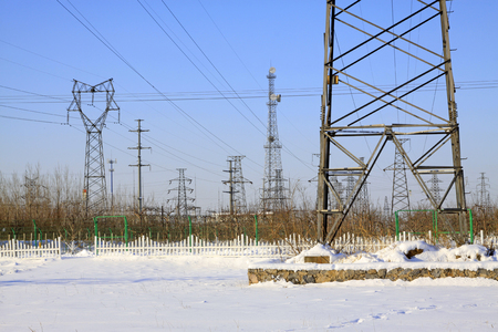 energia electrica: Electric power tower in the snow, closeup of photo