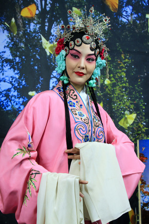 role models: LUANNAN  COUNTY - DECEMBER 13: Chinese traditional PingJu woman showing classical costumes, on december 13, 2014, Luannan County, Hebei Province, China Editorial