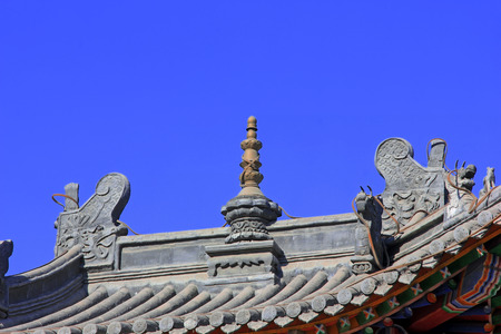 tantra: Copper sculpture and dragons head in the roof, closeup of photo