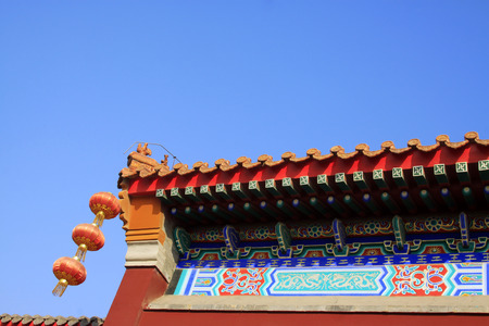 respectful: Lanterns and eaves in a temple