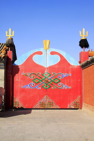 cultural artifacts: red iron gate in a temple, closeup of photo