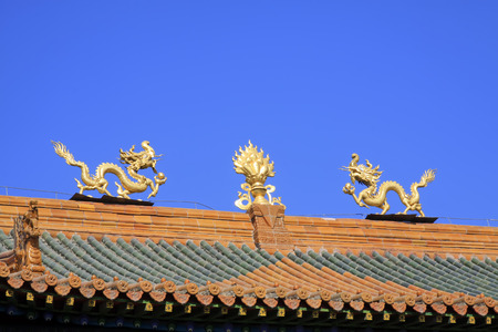 aureate: Glazed tile roof and Gilding copper Dharma chakra in a temple, closeup of photo Stock Photo