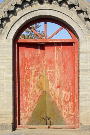 restore ancient ways: Wooden door in a temple, closeup of photo
