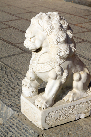 lions rock: gray rock steps and white marble stone lions, closeup of photo Stock Photo