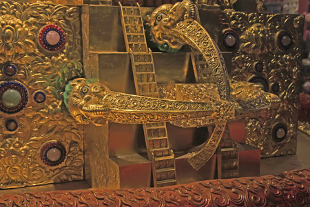 tantra: gilding bronze decoration in a temple, closeup of photo Editorial