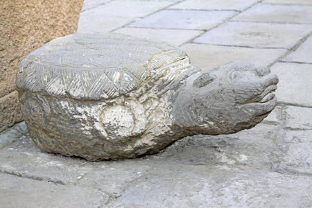 inner wear: turtle stone sculpture in a temple