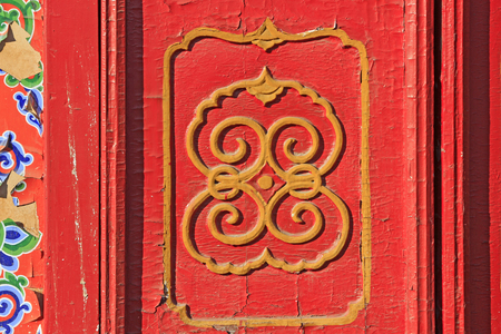 tantra: Decorative pattern on the red door plank, closeup of photo