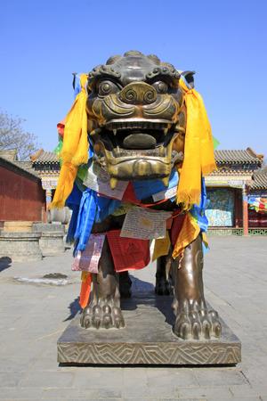 aureate:  Scalpers copper sculpture in the Dazhao Lamasery