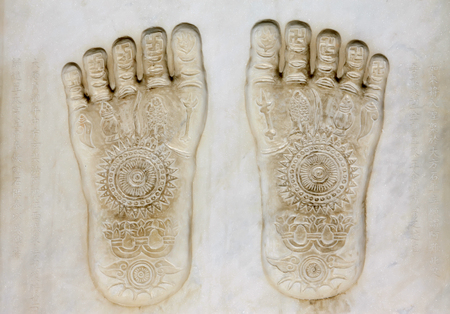 Buddha footprint on white marble stone in the Dazhao Lamasery
