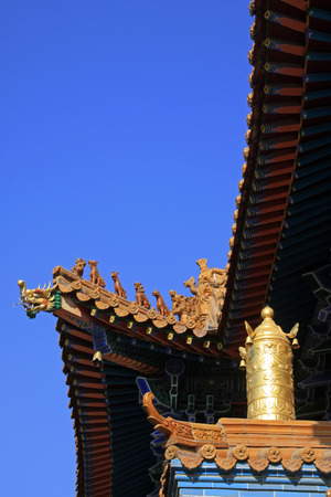 aureate: Glazed tile roof and Gilding copper decoration in a temple, closeup of photo Stock Photo