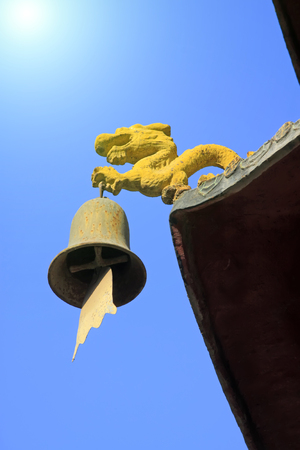 modelling: Dragon modelling wind chimes in a temple, closeup of photo