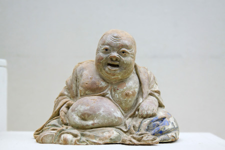 inner wear: Maitreya like clay sculpture  Stock Photo