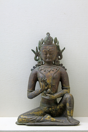 inner wear:  Gold and copper bodhisattva sculpture
