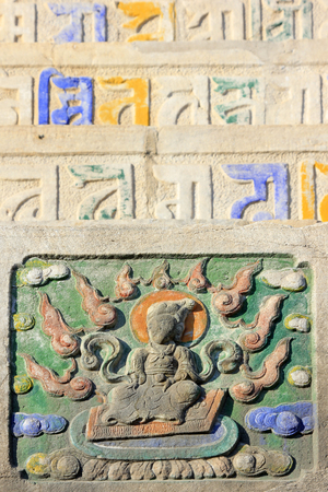 embossment: Buddhist scriptures and embossment on the rock in a temple, closeup of photo Stock Photo